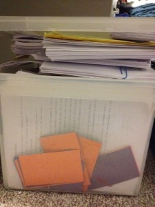 An overflowing box of my YA novel drafts and revisions